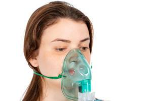 Mask for inhalation on the girl