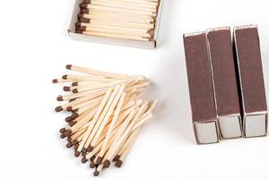 Matchbooks and scattered matches on a white background (Flip 2020)
