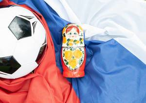 Matryoshka doll with soccer ball on Russian flag