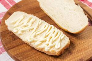 Mayonnaise with Bread on the wooden board