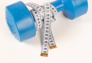 Measuring tape and dumbbell