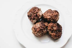 Meatballs in white plate. White background.