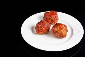 Meatballs with Tomato Sauce on the white plate