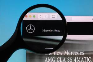 Mercedes-Benz logo under magnifying glass