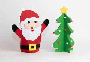 Merry Christmas: kids handicraft with happy Santa and decorated tree