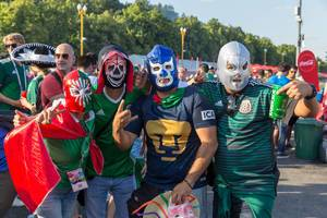 Mexican soccer fans wearing masks