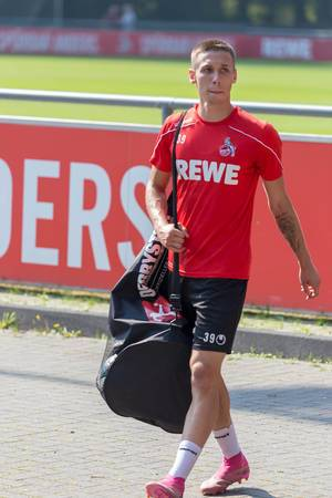Midfielder Darko Churlinov walks with packed bag after team training at the clubhouse of FC Cologne, Germany
