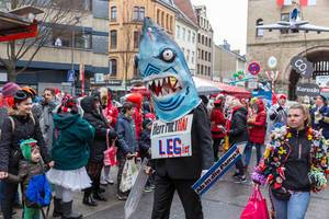 Miethai: Man in shark costume at Cologne carnival
