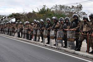 Military Police Officers standing on the Side of Street at World Cup 2014 in Brazil with full Equipment