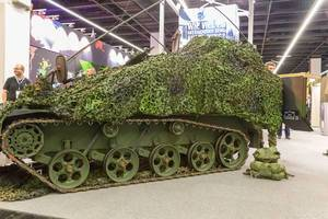 Military track vehicle with forest camouflage