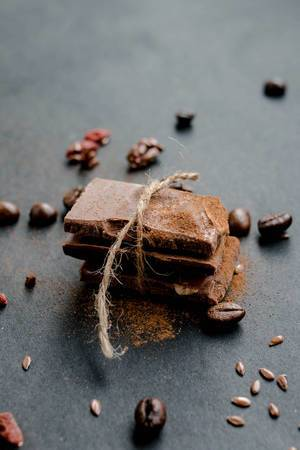 Milk chocolate pieces with coffee beans and cinnamon