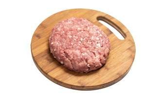 Minced Meat on the kitchen wooden board