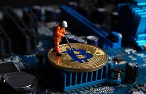 Miner working on a Bitcoin on computer motherboard