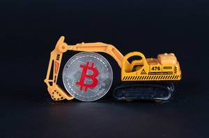 Miniature excavator with Bitcoin