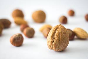 Mix a Nuts with Walnut Close Up in Front