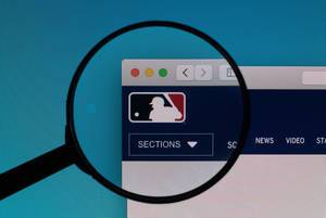 MLB.com logo under magnifying glass