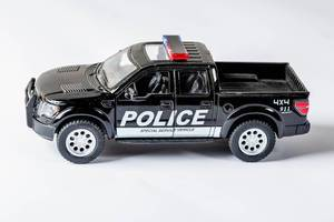 Model of a black police car Ford
