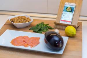Modern Cooking concept with vegetables and a recipe on the smartphone