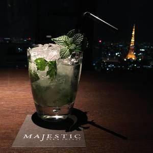 Mojito Cocktail with crushed ices and mint leaves in the Majestic Bar with a view of Tokyo at night