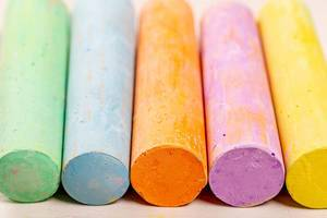 Multi colored crayons on white background