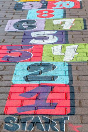 Multi-colored drawing on the pavement with numbers. Children