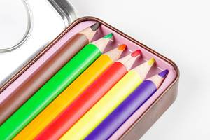 Multi-colored pencils in a pencil case close-up