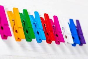 Multi-colored wooden clothespins for clothes