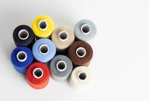 Multi-coloured cotton reels seen from above