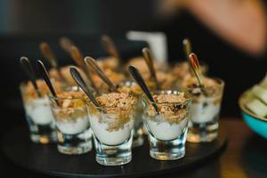 Musli And Cream Dessert On Glass Cups