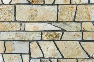 Nahaufnahme einer Wand aus Stein