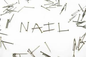 Nails forming the word NAIL