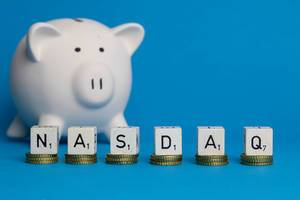 Nasdaq text with piggy bank