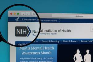 National Institutes of Health logo under magnifying glass