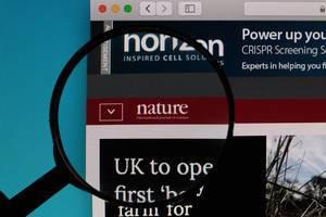 Nature website under magnifying glass