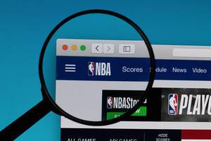 NBA logo under magnifying glass