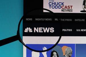 NBC News logo under magnifying glass