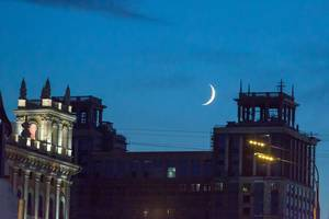 New moon above the rooftops of Moscow