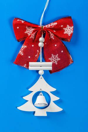 New year decorations for the Christmas tree with bell on blue