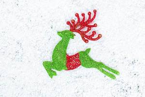 New year toy deer on snow background
