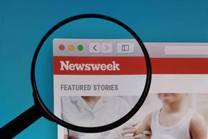 Newsweek logo under magnifying glass