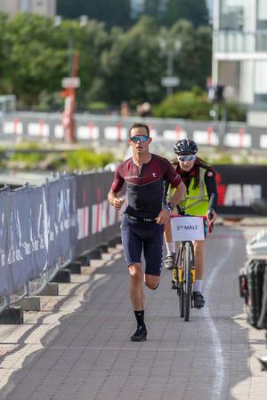Nicholas Kastelein runs the marathon during the Ironman 70.3 - Triathlon in Lahti, Finland, with bicycle escort