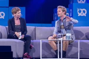 Nico Rosberg talking to interviewer at the Bits & Pretzels Festival 2018