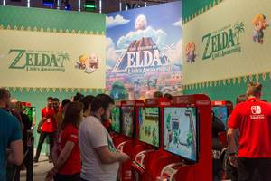 Nintendo Switch games fair station at Gamescom in Cologne, Germany: People testing and playing The Legend of Zelda - Link