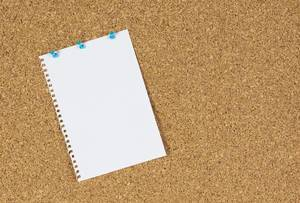 Note paper pinned on cork board