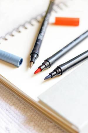 Notizblock mit Stiften