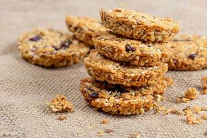 Oatmeal cookies with seeds and dried fruits on burlap