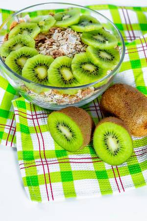 Oatmeal with kiwi fruit on a kitchen towel