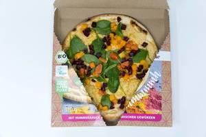 Offene Packung von Followfood Yoga-Pizza Vegan. Mit Bio-Dinkelboden und ausgewähltem Bio-Gemüse