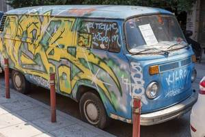 Old VW van covered with graffiti
