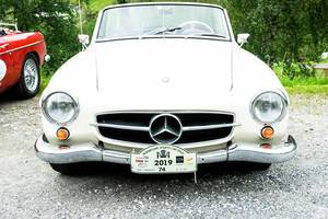 Old white Mercedes Benz car